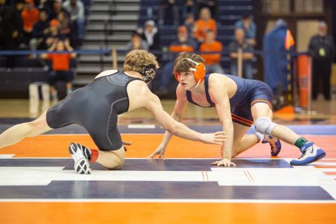 Justin Cardani wrestles against a Purdue opponent at Huff Hall on Sunday.