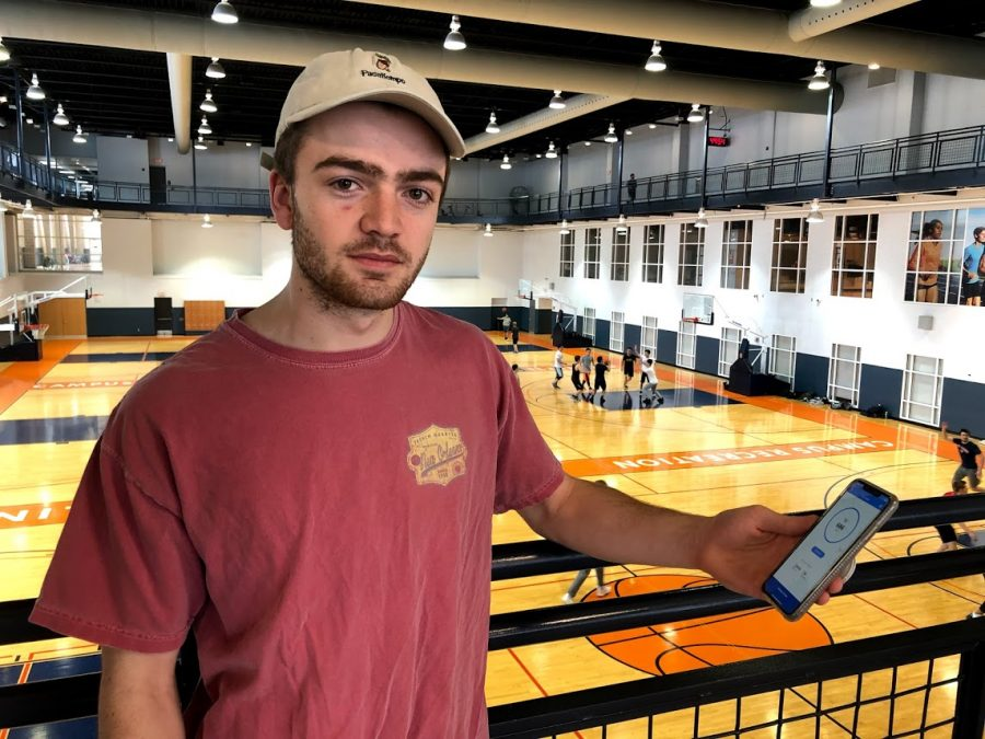 Jack Craig, freshman in engineering  holds the Plyo app open on his phone at the ARC on Saturday.