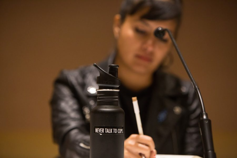 Activist Barbara Suarez Galeano takes notes as other co-panelists speak at the Immigrant Justice Panel at the Knight Auditorium on Thursday. She argues the Department of Defense needs to stop cutting funding from Immigration and Customs Enforcement.