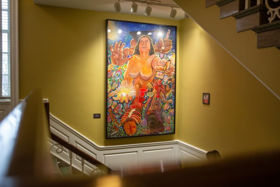 """""""La Victoria"""" by Oscar Martinez rests in the southwestern stairway of the Illini Union on Saturday. The mural's restoration project just concluded after over three years of work."""