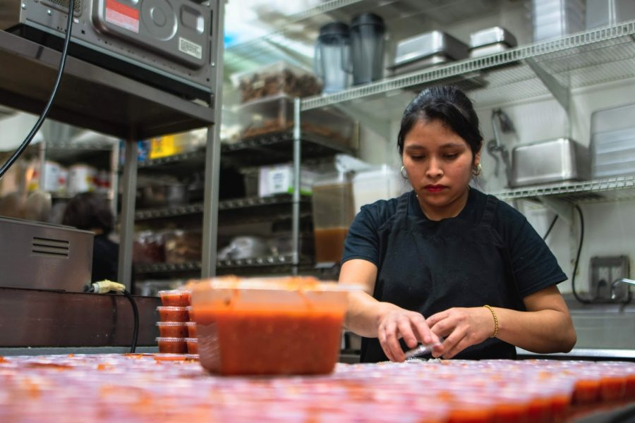 Marileny Rodriguez prepares red sauces for the lunch rush at Maize Mexican Grill, 60 E. Green St., on Feb. 9.