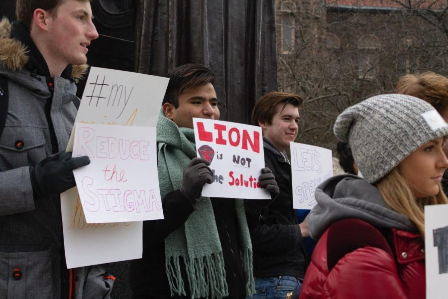 Students protest the state of campus mental health services on Dec. 11. The University and student activists plan to join forces to battle the stigma surrounding mental health.