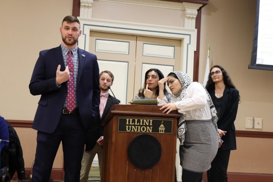 Illinois+Student+Government+senator+Ben+Crane+answers+a+question+about+the+proposed+amendment+to+Resolution+03.61+as+the+bill%E2%80%99s+authors+look+on.+The+resolution+passed+through+the+student+senate+on+Thursday+at+12%3A30+a.m.+in+Illini+Union+Rooms+B+and+C.+