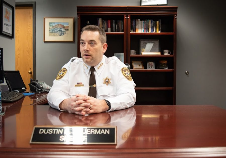 Champaign County Sheriff Dustin D. Heuerman explains the Illinois Sheriffs' Association scholarships in his office Friday. These scholarships are open and available for Illinois residents.