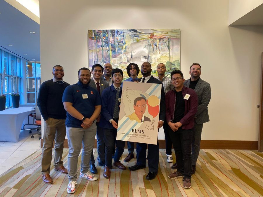 """Members of the Black and Latino Summit pose with the graphic promoting the 2020 Summit on Saturday. A decade-long event, this year's event was themed """"Unearthing the Root — Cultivating a New World."""""""