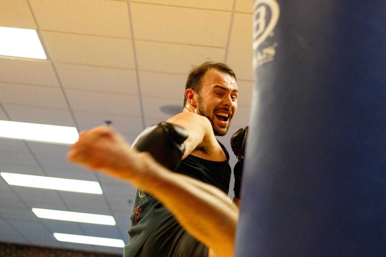 Adam Taggart, second year doctoral student in kinesiology, practices his kickboxing skills. This hobby turned into a field of research for Taggart, as he is studying the effects of martial arts on cognitive functions.