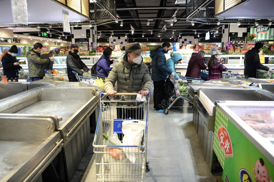 Masked shoppers in a supermarket in Wuhan, the epicenter of the coronavirus outbreak, in central China's Hubei province on Feb. 10. Many students on campus have been affected by the coronavirus as they have family members still living in China.