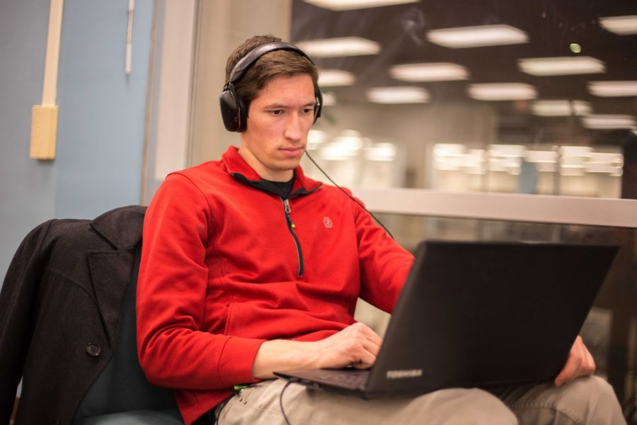 Konrad Kroczynski, junior in Engineering, studies in the Undergraduate Library on Dec. 12, 2017. Columnist Maii thinks YouTube Red sets the perfect tone for studying.