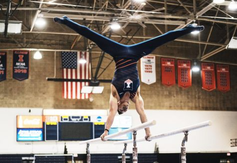 Sophomore Jordan Kovach performs on the Parallel bars for the Illini Orange and Blue meet on Nov. 11 at Huff Hall. Illinois beat Nebraska Saturday at Huff Hall, 276.20 - 267.40.