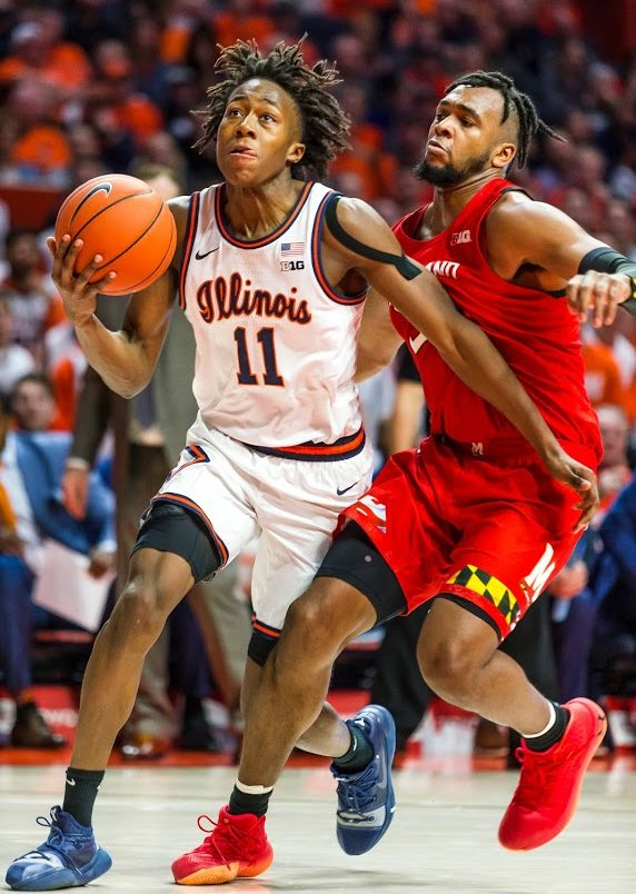 Sophomore guard Ayo Dosunmu drives toward the basket with pressure from Terrapin sophomore guard Eric Ayala during Illinois' game against No. 9 Maryland Friday. The Illini lost 75-66.