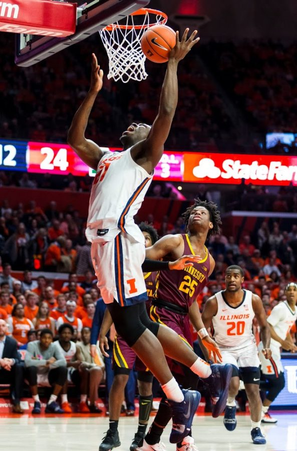 Freshman center Kofi Cockburn attempts a layup during the game against Minnesota on Thursday at the Statefarm Center. The Illini lost the match 59-51.
