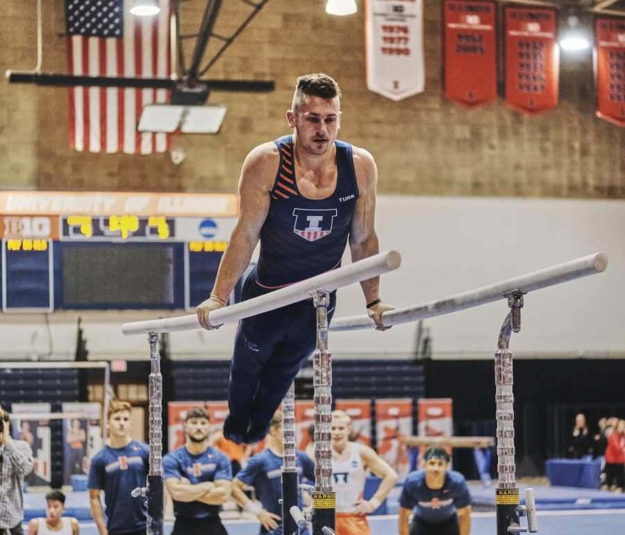 Junior Jordan Kovach performs on the parallel bars at the Illini Orange and Blue meet at Huff Hall on Nov. 8.  Kovach and his teammate Alex Diab will participate as individuals in the U.S.A. Gymnastics Winter Cup Challenge in Las Vegas this weekend.