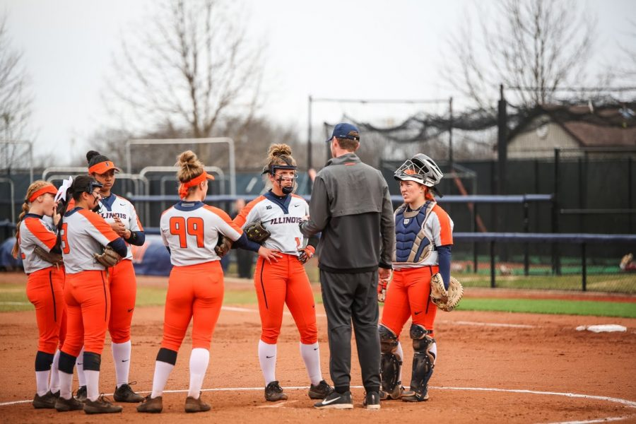 Taylor Edwards speaks to the UIUC baseball coach at the pitchers mound at Eichelberger Field on April 3.