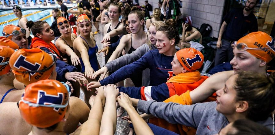 The+Illini+put+their+hands+together+during+the+Big+Ten+Championships+in+Iowa+City%2C+Iowa%2C+over+the+weekend.+The+team+came+in+13th+at+the+Big+Ten+Championships.