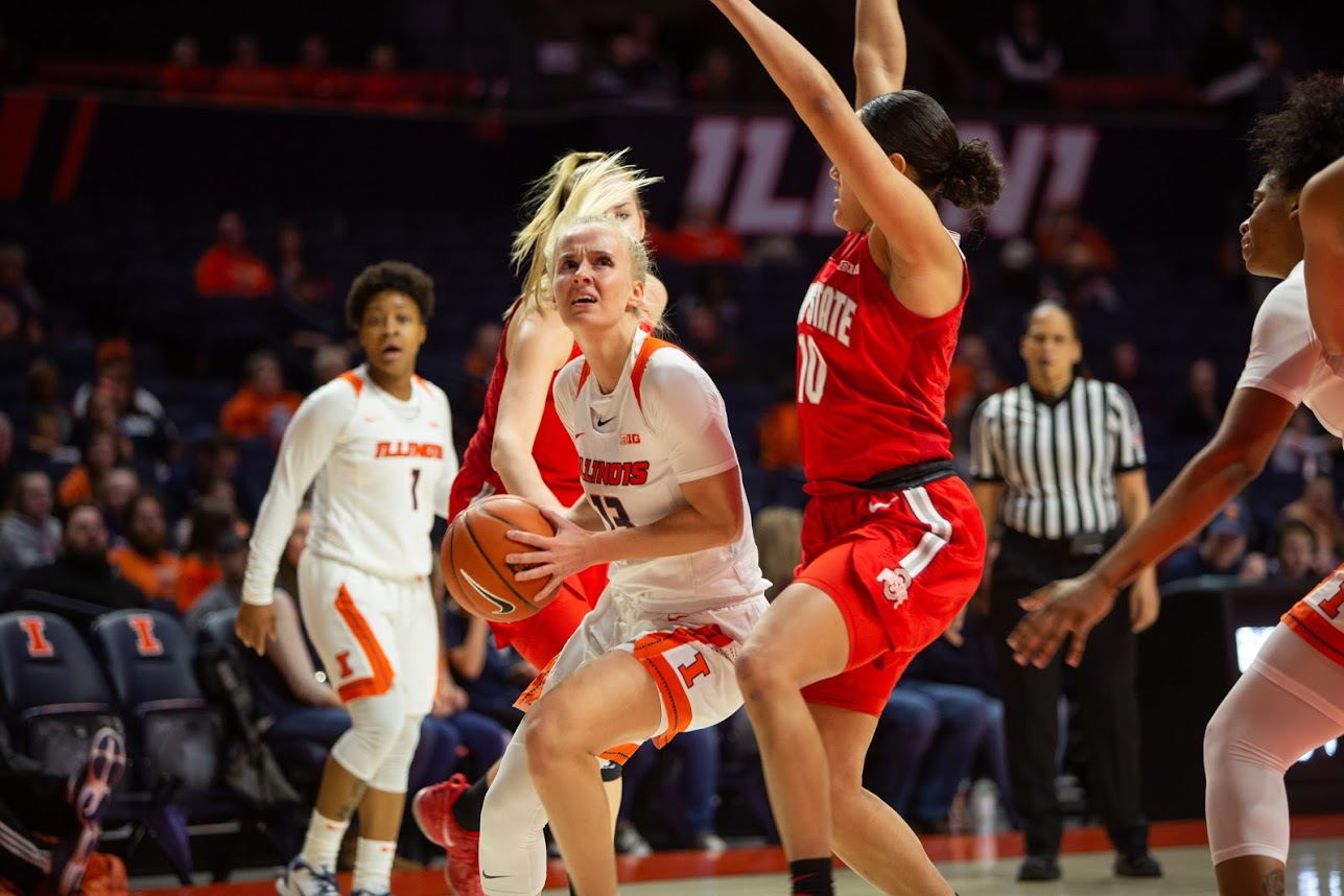 Redshirt-junior guard Petra Holešínská maneuvers around Ohio State defenders during the Illini's game against the Buckeyes at State Farm Center on Feb. 6. Illinois hosts No. 20 Indiana Thursday.
