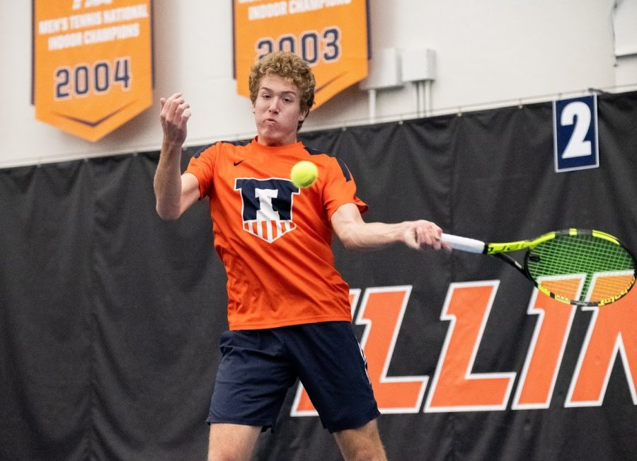 Alex Brown returns the ball during a game against Florida at the Atkins Tennis Center on Wednesday.