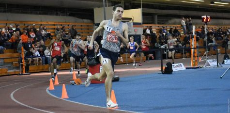 Jon Davis runs on the Armory's track for the one-mile run during the Illini Invitational.