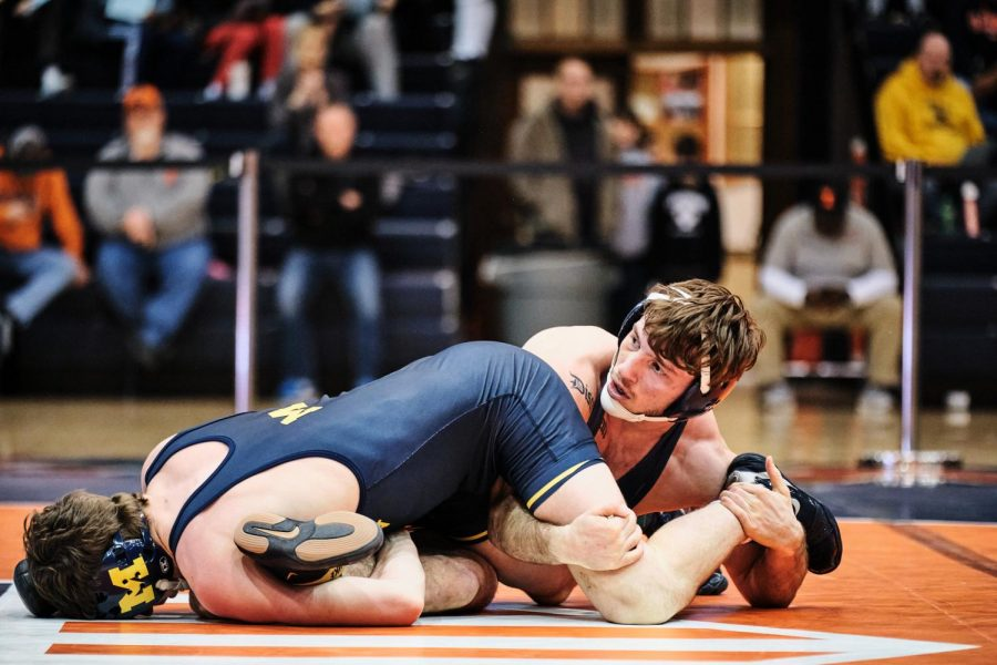 Dylan+Duncan+takes+down+Michigan+opponent+Cole+Mattin+during+the+Illinois+dual+against+Michigan+at+Huff+Hall+on+Jan.+26.