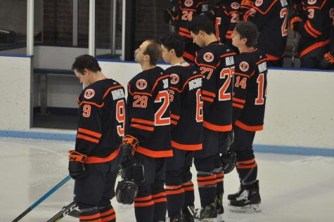 The Illini hockey team listens to the National Anthem before a game against Ohio University Dec. 6. The Illini anticipate an intense matchups against Davenport this weekend since the playoffs are right around the corner.