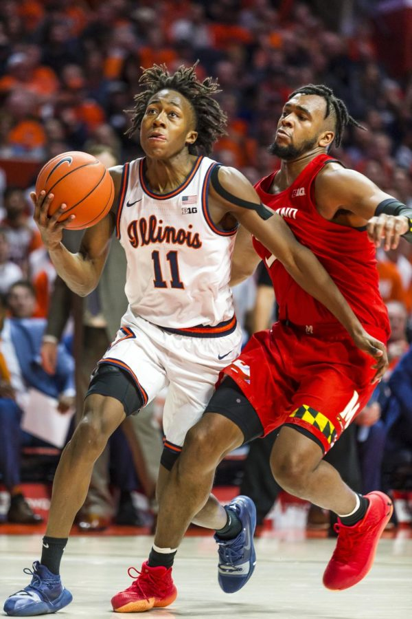 Ayo Dosunmu drives for a layup passing a Maryland defender.
