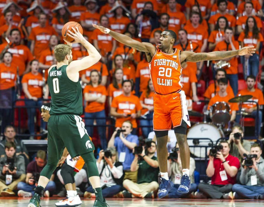 Illini guard Da'Monte Williams (20) guards Michigan State guard Kyle Ahrens (0) during the first half of Tuesday's matchup at the State Farm Center. Illinois fell to Michigan State 70-69.