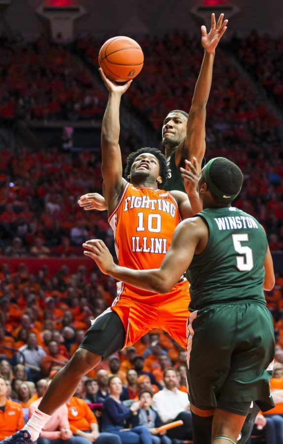 Senior guard Andrés Feliz   attempts a layup midst pressure from Michigan State starting, senior guard Cassius Winston and starting, sophomore forward Aaron Henry during No. 22 Illinois' game against Michigan State at the State Farm Center on Tuesday. The Illini lost, 70-69, despite a large second-half comeback. Photo by Jonathan Bonaguro of the Daily Illini.