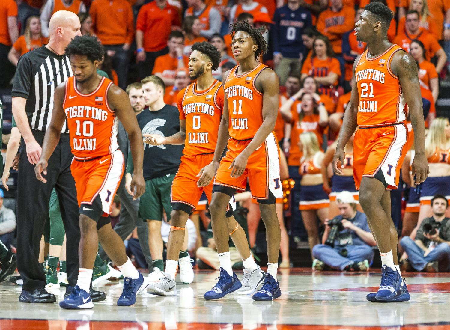 Illini sophomore guard Ayo Dosunmu (11), freshman center Kofi Cockburn (21), sophomore guard Alan Griffin (0), and senior guard Andres Feliz (10) head to the bench for a timeout during the second half at State Farm Center on Feb. 11. Illinois travels to New Jersey Saturday to face Rutgers.