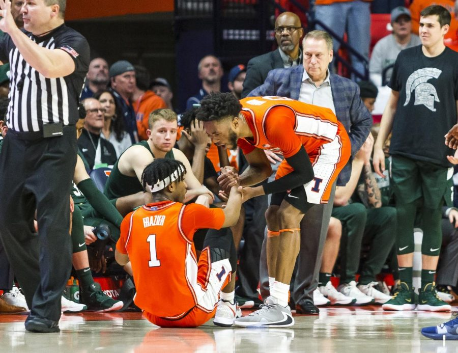 Illini sophomore guard Alan Griffin helps Illinois junior guard Trent Frazier after he picks up an offensive foul during the second half of Illinois' game against Michigan State at State Farm Center in Champaign, IL on Tuesday, Feb. 11.