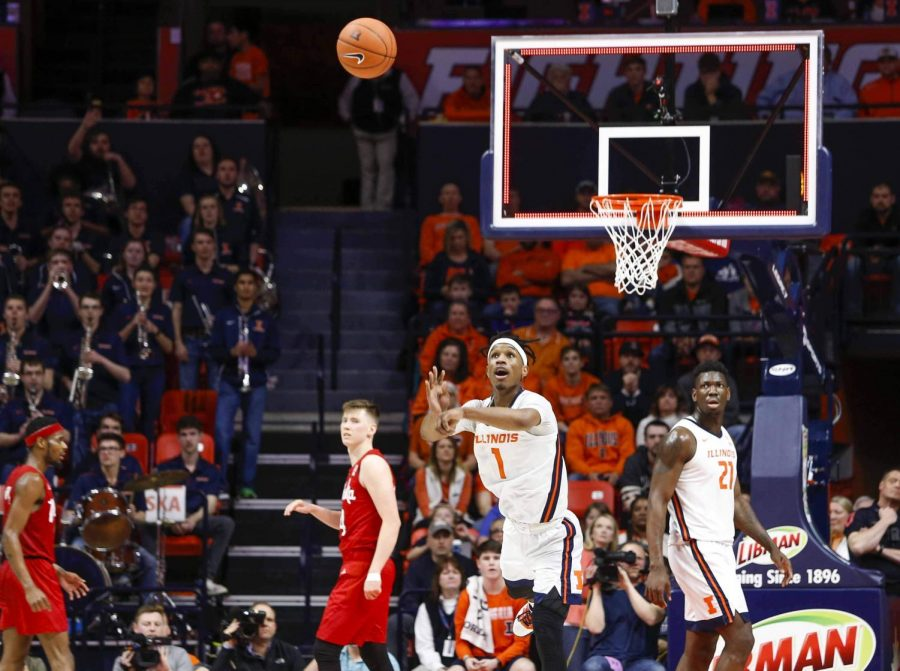 Junior guard Trent Frazier shoots the ball from half court to secure the lead for Illinois at halftime 37 -31. The Illinois basketball team defeated Nebraska 71 - 59 at State Farm Center on Monday.