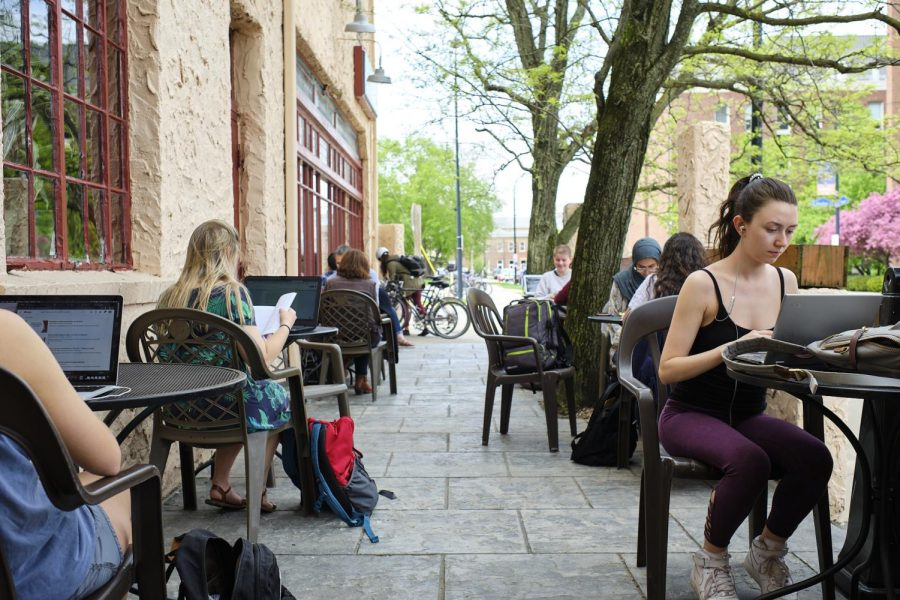 Students sit in the outdoor seating of Espresso Royale in Urbana on May 5.