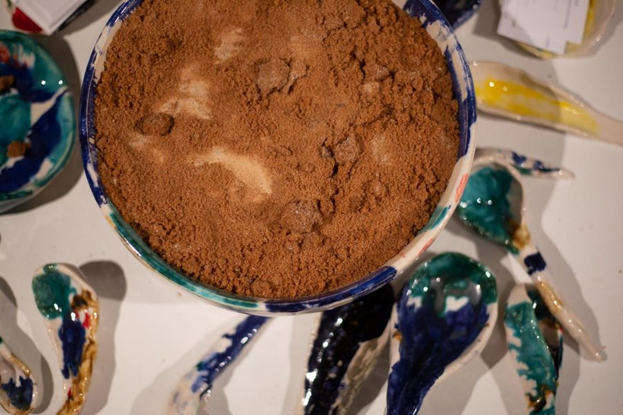 Alicia+De+Le%C3%B3n%27s+%22A+spoonful+of+brown+sugar%22+is+the+centerpiece+of+the+%E2%80%9CObjects+Who+Hold%2C+Objects+Who+Let+Go.%E2%80%9D+installation+in+the+copy+room+at+the+Department+of+Latino%2Fa+Studies+building.
