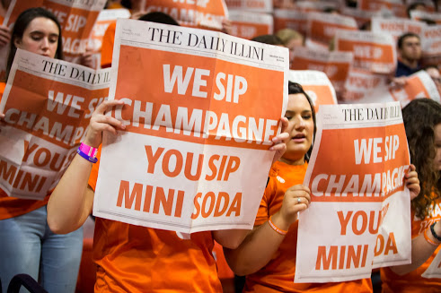 Fans hold up the Minnesota Special Edition at State Farm Center on Thursday.