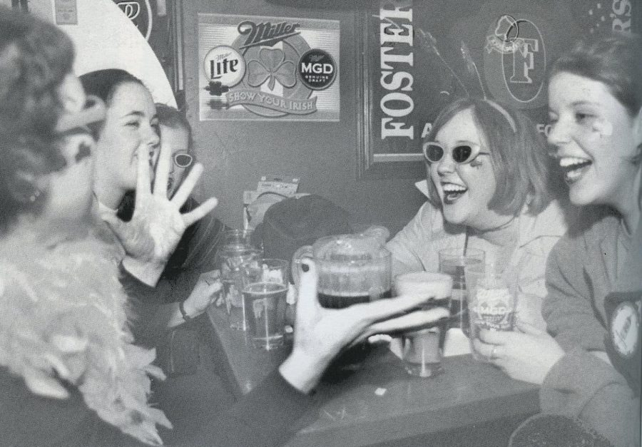 Students celebrate Unofficial at Murphy's in 2001. Since 1995, the drinking holiday has grown out of the bars and now involves the entire campus.