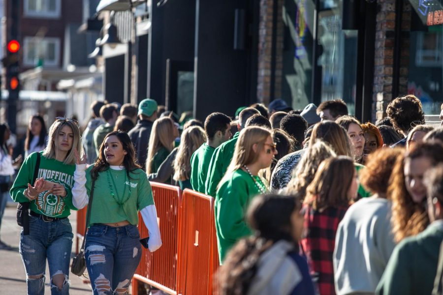 A sea of green fills the line at KAM's during Unofficial on Friday.