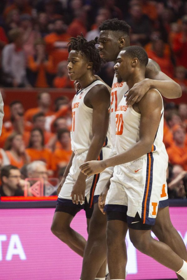 Ayo+Dosunmu+%28left%29%2C+Kofi+Cockburn+%28middle%29+and+Da%27Monte+Williams+%28right%29+head+to+the+sideline+during+the+game+against+Iowa+on+March+8.+The+Illini+defeated+the+Hawkeyes+78-76.
