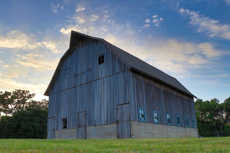 The+barn+on+the+Birch+family+farm+stands+tall+at+dusk.+The+Birch+family+has+farmed+the+same+land+for+150+years.