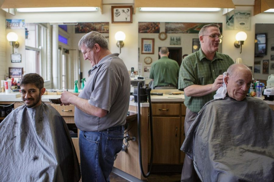 A+man+receives+a+haircut+at+Depot+Barber+Shop+located+at++100+N.+Chestnut+St.+Friday.%0AThe+street%2C+located+in+downtown+Champaign%2C+is+now+part+of+the+certified+national+historic+district.