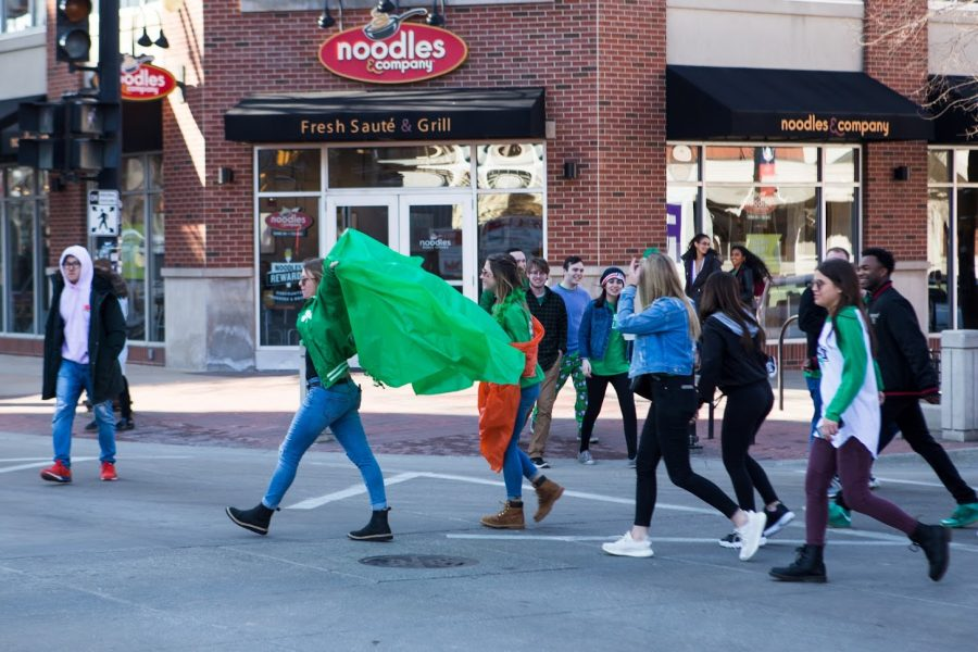 Students cross the intersection of Green and Sixth streets during Unofficial 2019. This green series of events offers drinking festivities for students around campus.