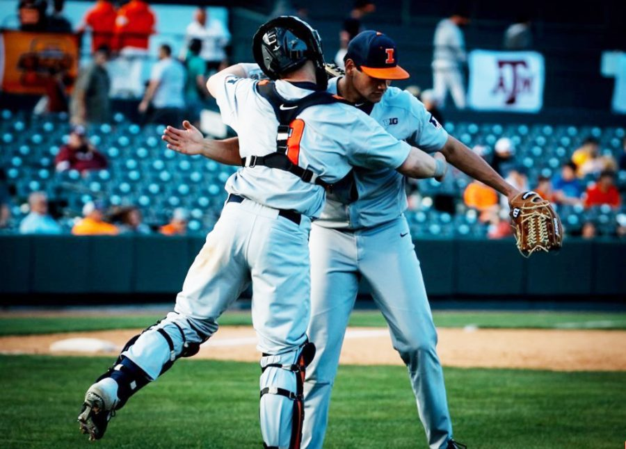 Senior pitcher Garrett Acton celebrates with sophomore catcher Jacob Campbell after defeating Oklahoma State 4-2 at Frisco, Texas, on Saturday. Illinois picked up wins against Texas A&M and Oklahoma State and fell to the University of California, Los Angeles this weekend.