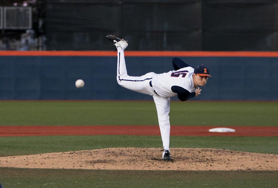 Sophomore right hand pitcher Caleb Larson throws the ball during the Illinois' season opener against Chicago State at Illinois field on Tuesday. The Illini won 11-8.