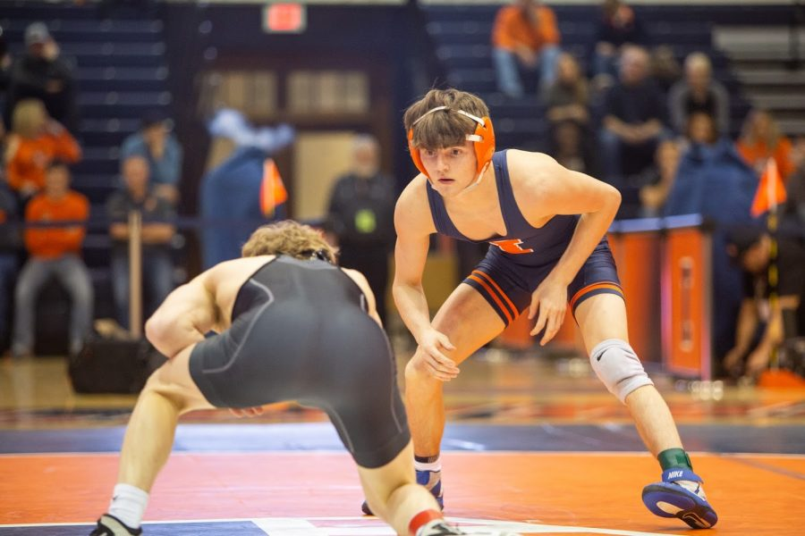Freshman Justin Cardani looks at his opponent during the meet against Purdue on Feb. 16 at Huff Hall. Cardani has earned the No. 4 seed spot and holds a No. 19 national ranking.