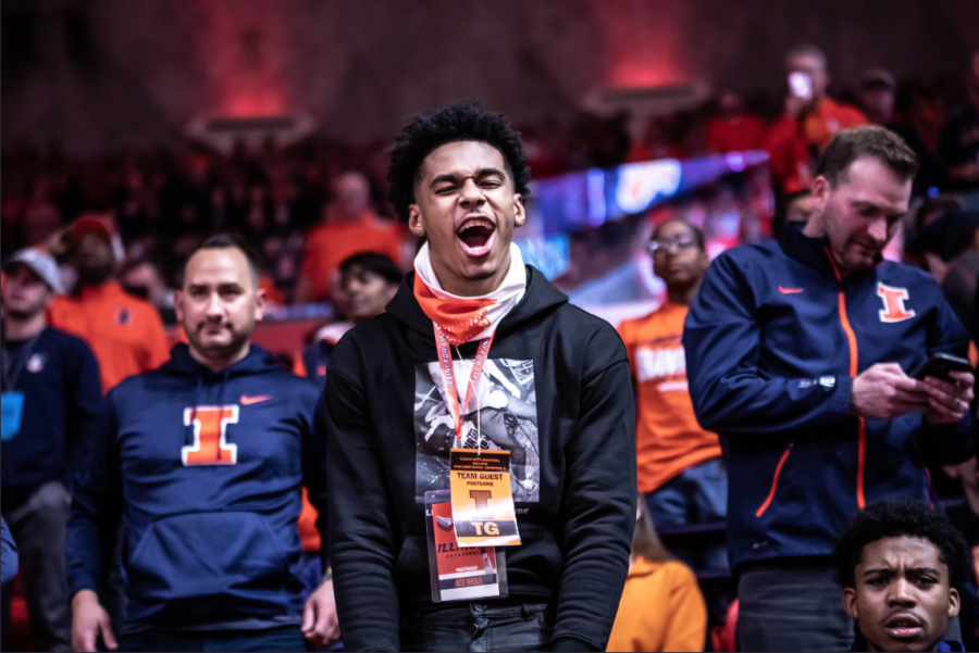 Illinois+basketball+commit+Adam+Miller+cheers+while+watching+Illinois%E2%80%99+game+against+Indiana+on+March+1+at+State+Farm+Center.+Miller+will+join+the+Illini+for+the+2020-2021+season.