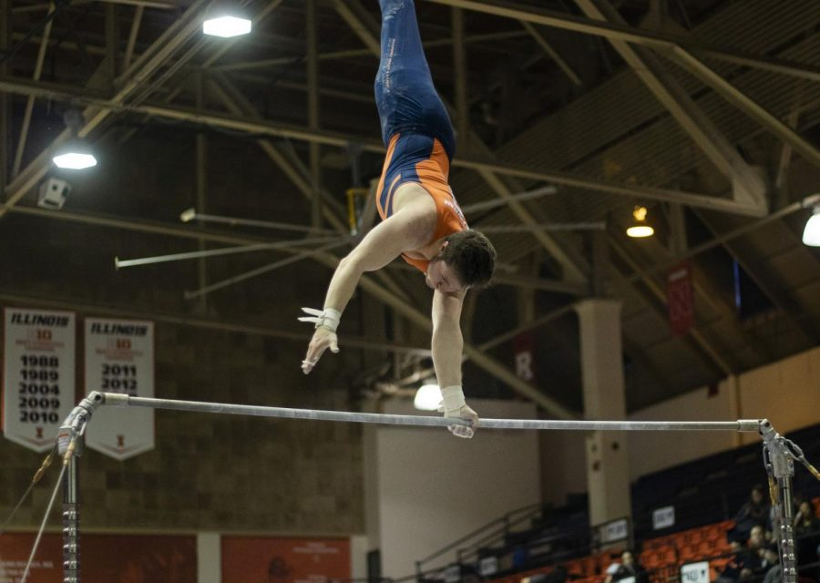Junior Zach Treadway competes in the high bar event during the meet against Penn State and Michigan on Saturday. The Illini left on Wednesday to compete at the Puerto Rico Invitational this weekend.