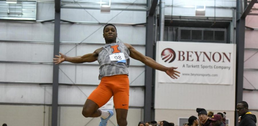Redshirt senior Jonathan Wells jumps during the first day of Big Ten Indoor Championships at the SPIRE Institute on Saturday. Wells won the long jump title, jumping 7.65 meters.