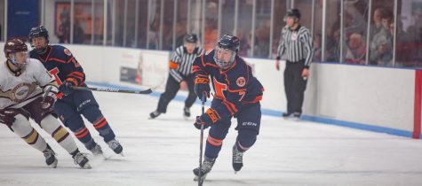 Freshman forward Zack Hayes skates down the rink while guiding the puck during the match against Robert Morris University on Saturday. The Illini won the Senior Night game 7-1.