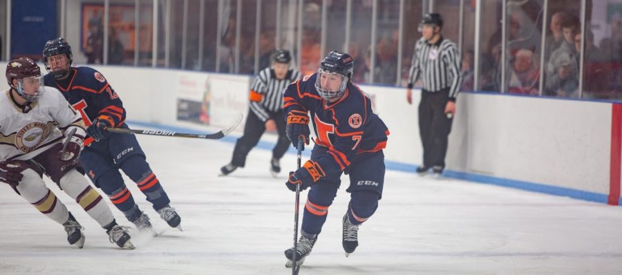 Freshman+forward+Zack+Hayes+skates+down+the+rink+while+guiding+the+puck+during+the+match+against+Robert+Morris+University+on+Saturday.+The+Illini+won+the+Senior+Night+game+7-1.%0A