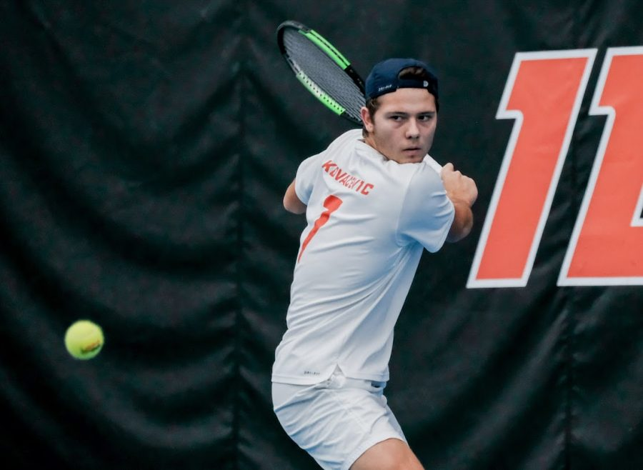 Senior Aleks Kovacevic prepares to return the ball against Chicago State on Feb. 15. Illinois won the match, 4-0.
