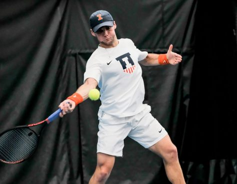 Zeke Clark returns the ball during the meet against Chicago State at Atkins Tennis Centeron Feb. 15.