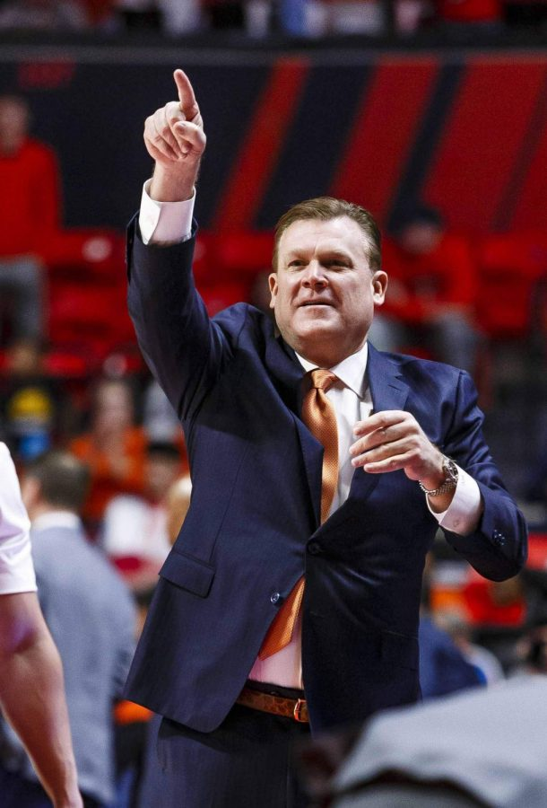 Illinois head coach Brad Underwood directs a play from the sidelines during Illinois' game against Indiana at State Farm Center Sunday afternoon. Illinois topped Indiana 67-66. Underwood and members of his coaching staff received contract extensions into 2026 and 2022, respectively, Illinois' Department of Intercollegiate Athletics announced Monday afternoon. Photo by Jonathan Bonaguro of The Daily Illini.