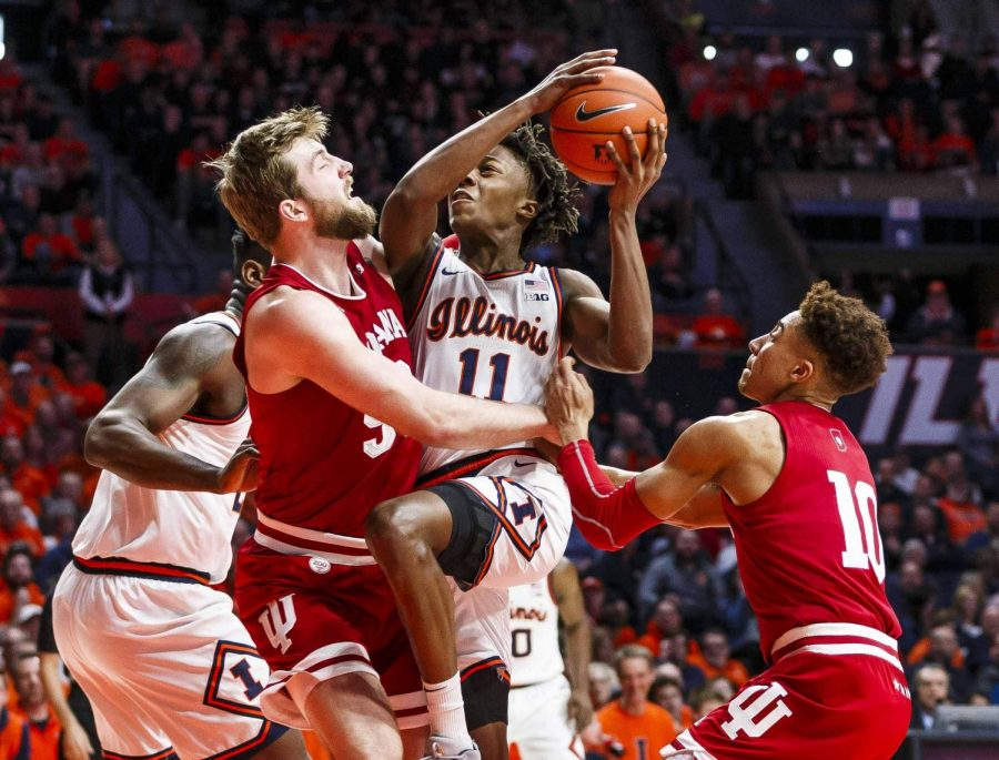 Sophomore guard Ayo Dosunmu drives through two Indiana players toward the basket during the Illinis game against the Hoosier at State Farm Center Sunday afternoon. Dosunmu led Illinois to a 67-66 victory over Indiana with 17 points on the day.
